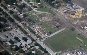 This Thursday, April 18, 2013 file aerial photo shows the remains of a nursing home, left, apartment complex, center, and fertilizer plant, right, destroyed by an explosion in West, Texas on April 17. (AP / Tony Gutierrez)
