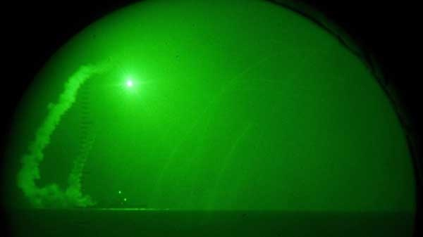 An image from night-vision lenses shows a Tomahawk missile being launched from the U.S. Navy destroyer Barry on Saturday, March 19, 2011.
