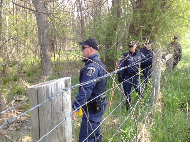 Police search a farm property in North Dumfries, Ont., in connection with the death of Tim Bosma. (Kevin Doerr / CTV Kitchener)