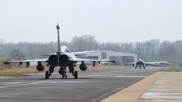 Rafale jet fighters take off from the military base of Saint Dizier, eastern France, Saturday, March 19, 2011. (AP /  ECPAD, Sebastien Dupont)