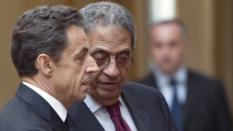 French President Nicolas Sarkozy, left, and Arab League Secretary-General Amr Moussa discuss in the Elysee Palace in Paris, during a crisis summit on Libya, Saturday, March, 19, 2011. (AP / Lionel Bonaventure, Pool)