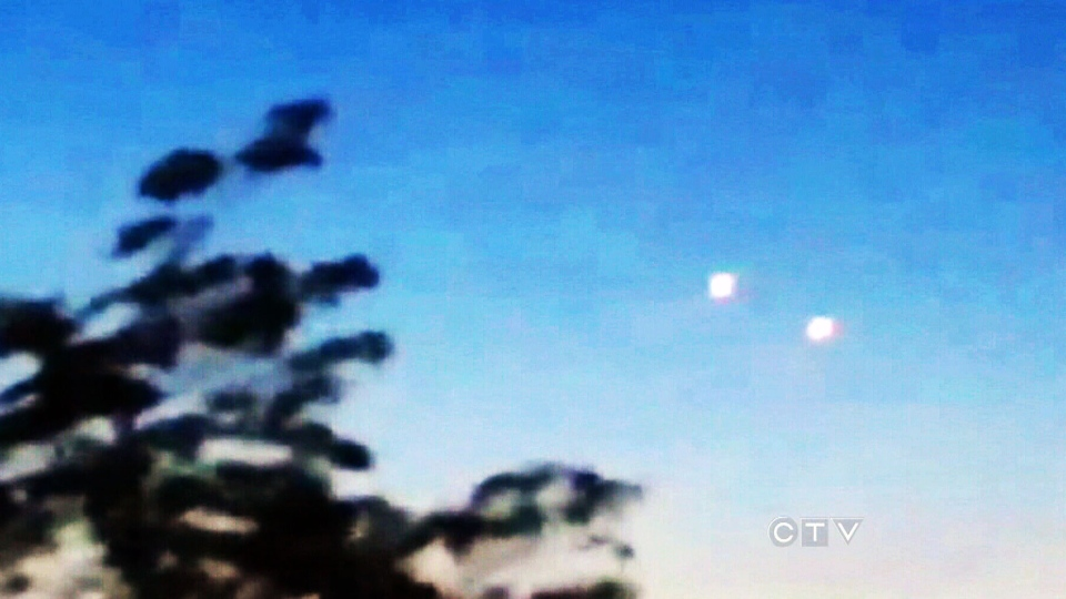 Unidentified Flying Objects are seen in the sky. Canadians reported nearly 2,000 sightings of UFOs last year, setting a new record a national survey found.