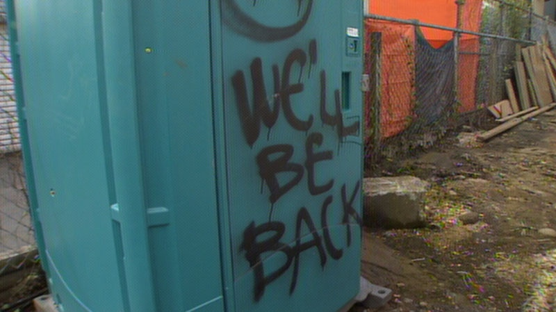 "A spray-painted message reading ""We'll be back"" was left behind the site of a house fire in East Vancouver early Wednesday morning. May 15, 2013. (CTV)"