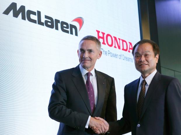 Honda Motor Co. President Takanobu Ito, right, poses with McLaren Group Ltd. CEO Martin Whitmarsh for photographers after their joint press conference in Tokyo, Thursday, May 16, 2013. (AP Photo/Shizuo Kambayashi)