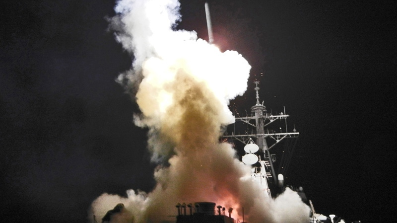 This Saturday, March 19, 2011 photo provided by the U.S. Navy shows the Arleigh Burke-class guided-missile destroyer USS Barry (DDG 52) as it launches a Tomahawk missile in support of Operation Odyssey Dawn from the Mediterranean Sea. (AP / U.S. Navy, Fireman Roderick Eubanks)