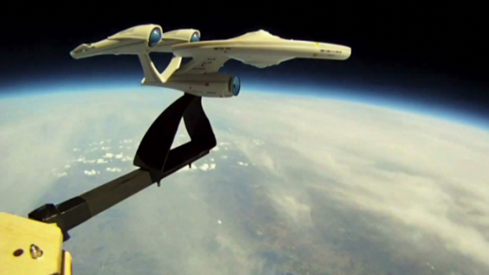 A miniature model of the famed Star Trek U.S.S. Enterprise is seen in the stratosphere.