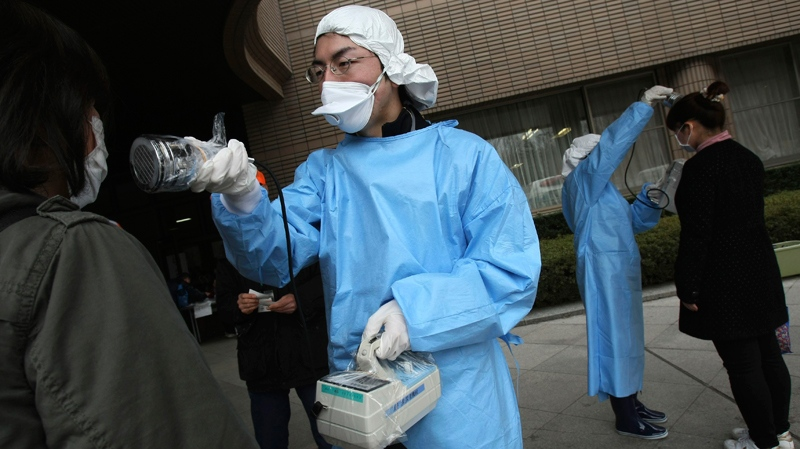 Women are screened at an evacuation center for radiation exposure leaked from the damaged Fukushima nuclear power plant, Sunday, March 20, 2011 in Fukushima, Fukushima Prefecture, northern Japan. (AP / Wally Santana)