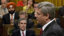 Prime Minister Stephen Harper responds to a question during Question Period in the House of Commons on Parliament Hill in Ottawa, Monday Sept.14, 2009 as Liberal Leader Michael Ignatieff looks on.