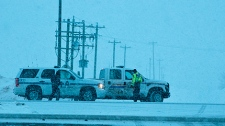 RCMP vehicles are seen at the site of the standoff. Photo courtesy William Vavrek Photography.