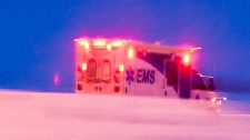 An ambulance is seen speeding away from the site where Bicknell surrendered to police. Photo courtesy: William Vavrek Photography.