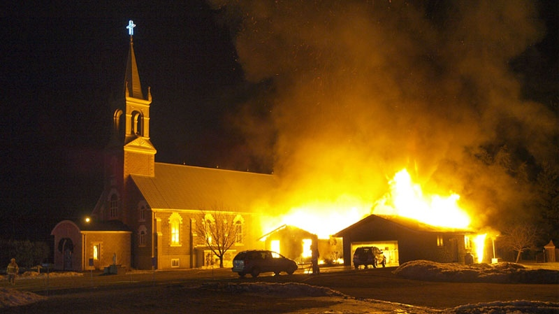 Flames ripped through the rectory of St. Casimir's Church near Killaloe, Ont., early Sunday, March 20, 2011. Credit: Ken Marchant