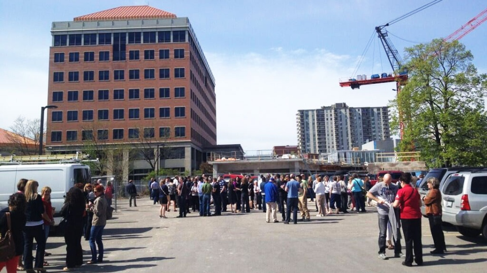 People stand outside a regional building that was evacuated after tremors were felt in Kitchener, Ont., on Friday, May 17, 2013. (Meghan Furman / CTV Kitchener)