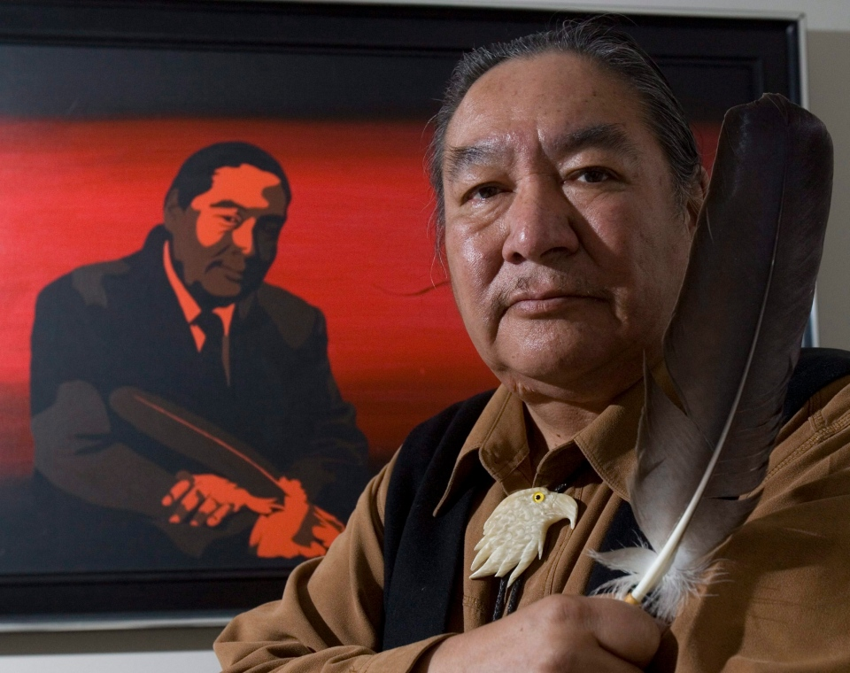 Former politician and honourary Cree Chief Elijah Harper holds up one of two eagle feathers he held during the Meech Lake proceedings in Ottawa in this May 2008 file photo. (Tom Hanson/THE CANADIAN PRESS)