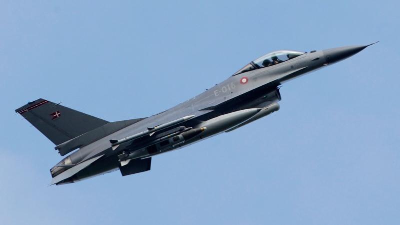 A F-16 flies over the NATO airbase in Sigonella, Sicily in 2011. (AP / Andrew Medichini)