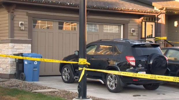 Investigators secure the scene on Evanspark Circle N.W.