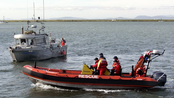 Canadian Coast Guard auxiliary patrols the Fraser River during a Sockeye Salmon fishery Tuesday, August, 16, 2006.(Chuck Stoody / THE CANADIAN PRESS)
