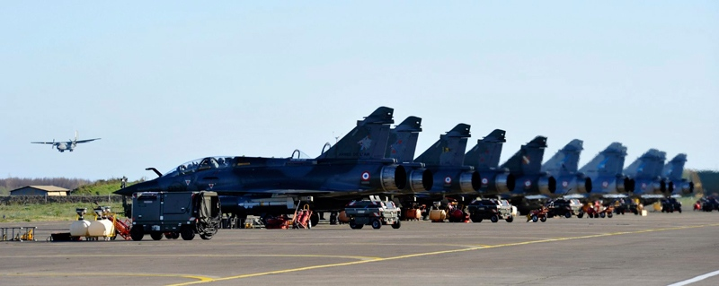 This photo provided Monday, March 21, 2011 by the French army shows a Mirage 2000 jet fighters parking on the tarmac of Solenzara air base after a mission to Libya, Corsica island, Mediterranean sea.