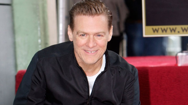 Canadian singer Bryan Adams is honored with a star on the Hollywood Walk of Fame in Los Angeles on Monday, March 21, 2011. (AP / Damian Dovarganes)