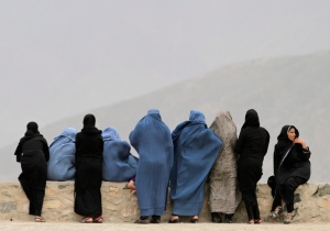 FILE - Afghan women look out over Kabul from the Naderkhan hill in Kabul, Afghanistan, Tuesday, April, 30, 2013. (AP / Ahmad Jamshid)