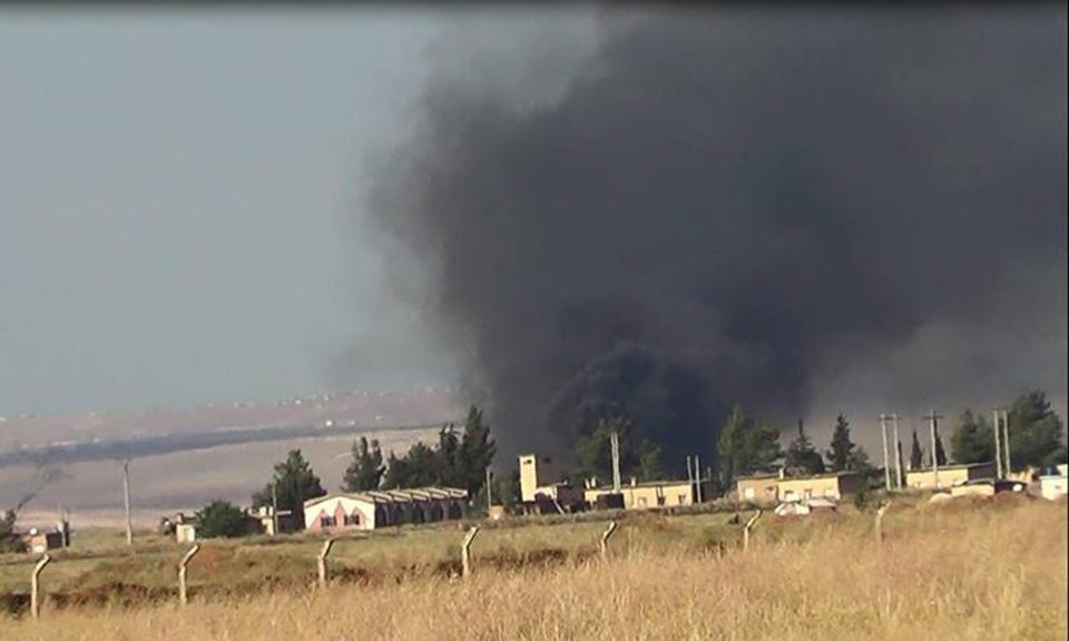 This citizen journalism image provided by Edlib News Network, ENN, shows black smoke rising from what rebels say is a helicopter that was shot down at Abu Dhour military airbase which is besieged by the rebels, in the northern province city of Idlib, Syria, Friday May 17, 2013. (AP)