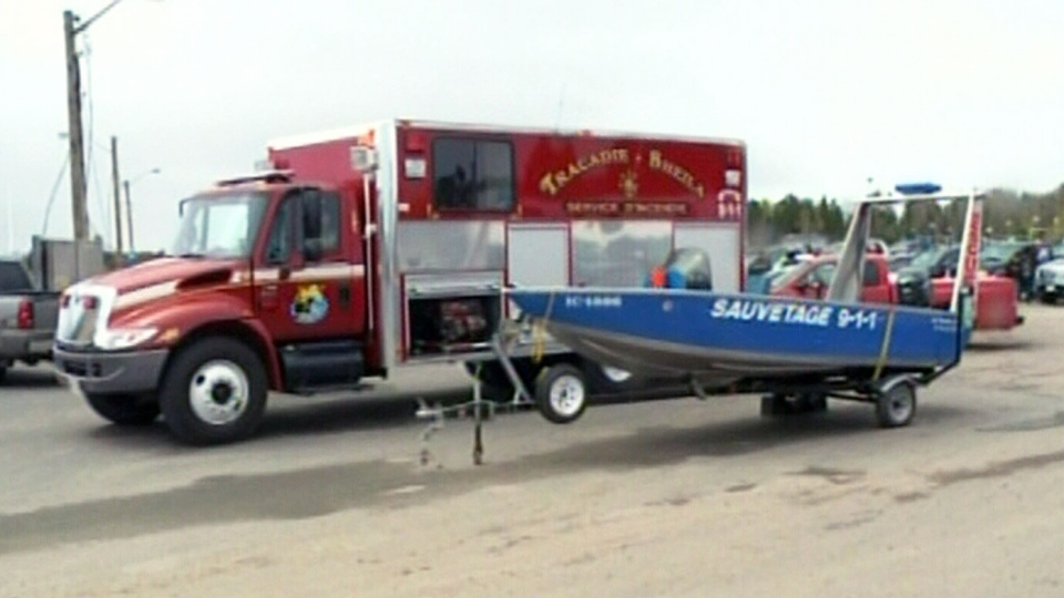 RCMP and local fire department worked to find two missing fishermen after their boat capsized off New Brunswick's northeast coast on Friday, May 17, 2013.