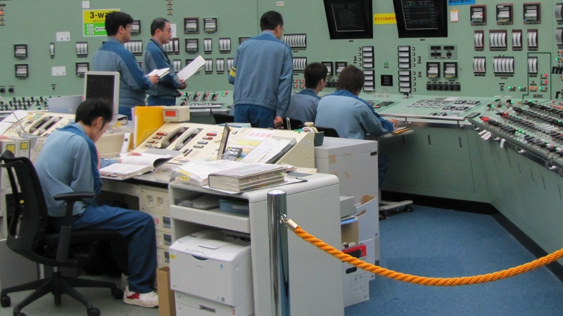In this September 2010 photo released by Tokyo Electric Power Co., workers are seen at work at the central control room of reactor Unit 3 of Tokyo Electric Power Co.'s Fukushima Dai-ichi nuclear complex at Okumamachi, northeastern Japan.