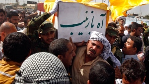 Family members of Mohammed Aboud, chant slogans against the Sunni-dominated Free Syrian Army rebel group and the al-Qaida-affiliated Jabhat al-Nusra during his funeral in Basra, Iraq's second-largest city, 340 miles (550 kilometers) southeast of Baghdad, Iraq, Friday, May 17, 2013. (AP / Nabil Al-Jurani)