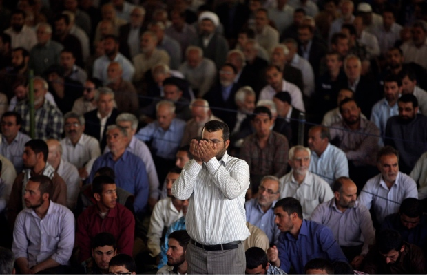 An Iranian worshipper prays at the start of Friday prayers at Tehran University in Tehran, Iran, Friday, May 17, 2013. (AP / Vahid Salemi)