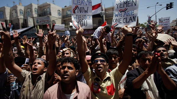 Anti-government protestors shout slogans and raise banners during a demonstration demanding the resignation of Yemeni President Ali Abdullah Saleh, in Sanaa, Yemen, Tuesday, March 22, 2011. (AP / Muhammed Muheisen)