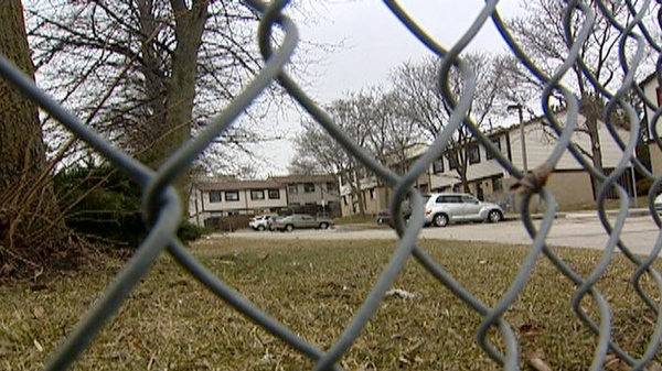 Nearly a dozen people were threatened with a butcher knife on Monday night near this townhouse complex on Westwood Road in Guelph, Ont. seen on Tuesday, March 22, 2011.