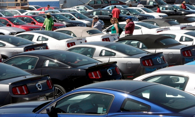 Potential new car buyers look through the Galpin Ford dealership lot in Los Angeles in this Aug. 24, 2009 file photo. (AP / Nick Ut)