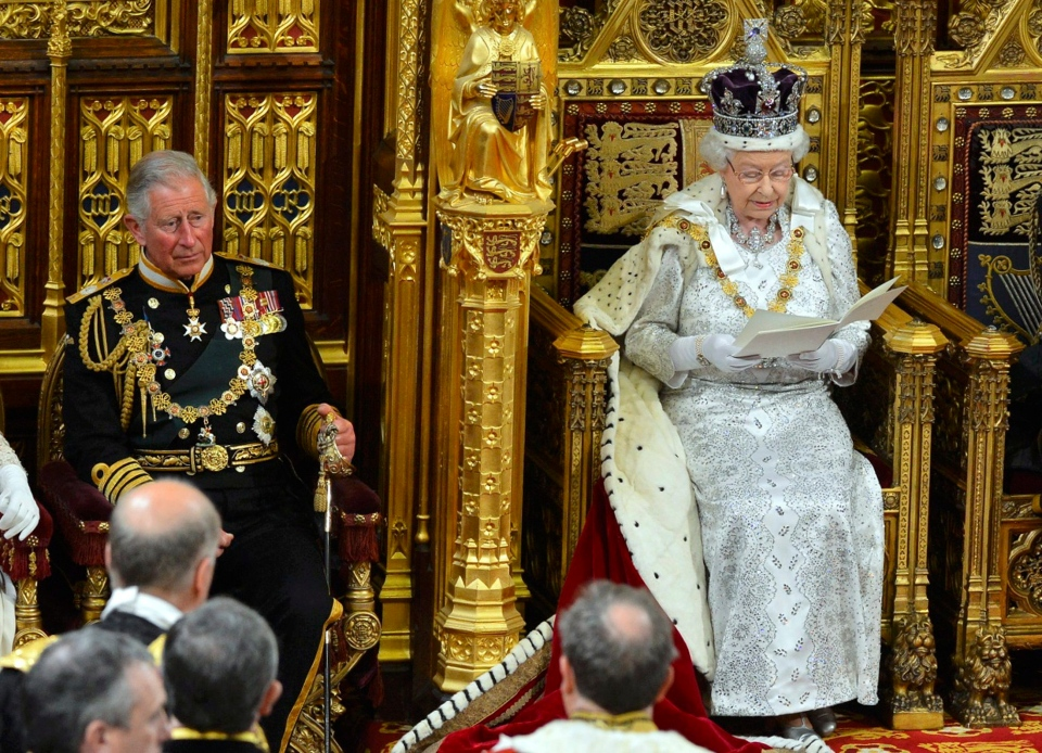 Queen Elizabeth delivers her speech during the State Opening of Parliament at the House of Lords, alongside Prince Charles in London Wednesday May 8, 2013. (AP / Toby Melville)
