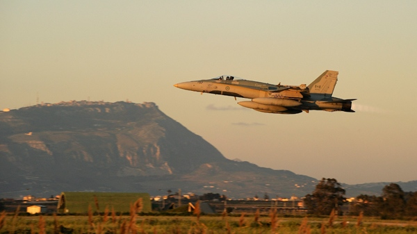 A CF-18 Hornet of the 425th Tactical squadron takes off from Trapani, Italy on Tuesday, March 22, 2011. (HO, DND - Cpl. Marc-Andre Gaudreault / THE CANADIAN PRESS)