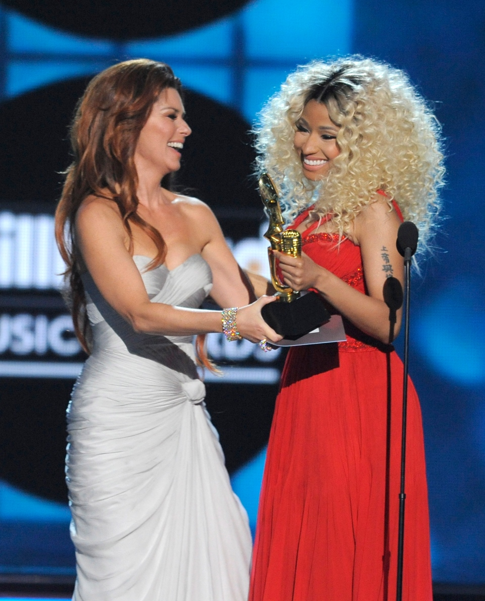 Shania Twain presents the award for top rap artist to Nicki Minaj at the Billboard Music Awards at the MGM Grand Garden Arena in Las Vegas on Sunday, May 19, 2013. (Chris Pizzello / Invision)