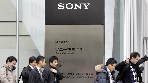 Office workers leave the headquaters of Sony Corp. in Tokyo Thursday, March 10, 2011. (AP Photo/Koji Sasahara)