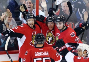 Ottawa Senators Daniel Alfredsson (11) celebrates with teammates Milan Michalek (9), Sergei Gonchar (55) and Mika Zibanejad (93) in the third period of game four of the Eastern Conference Stanley Cup semi-final NHL hockey action on Sunday May 19, 2013 in Ottawa. (The Canadian Press / Fred Chartrand)