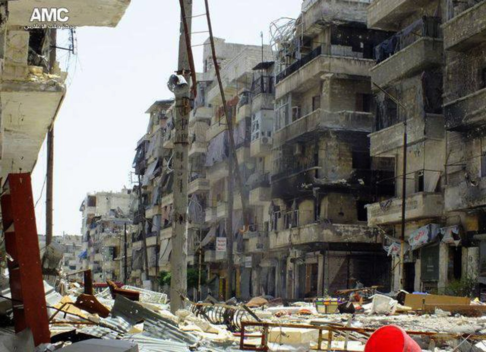 Buildings were damaged during battles between the rebels and the Syrian government forces, in the Salaheddine neighborhood of Aleppo, Syria, Monday May 20, 2013. (Aleppo Media Center / AMC)