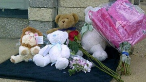 Many people have been placing toys and flowers at the scene of a collision that killed a 2-year-old boy.