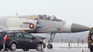 A Qatar Emiri Air Force Dassault Mirage 2000-5EDA fighter jet prepares for takeoff from Larnaca international airport, Cyprus, Tuesday, March 22, 2011. (AP / Christos Thedorides)