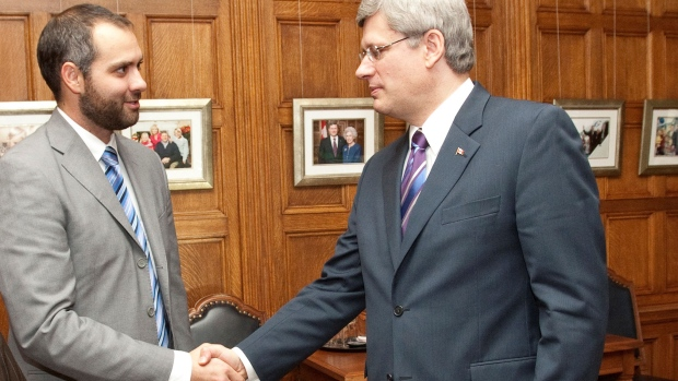 Benjamin Perrin with Stephen Harper. Perrin served as a lead policy adviser on matters related to the Department of Justice, Public Safety Canada and Citizenship and Immigration Canada. (Photo: Office of the Prime Minister)
