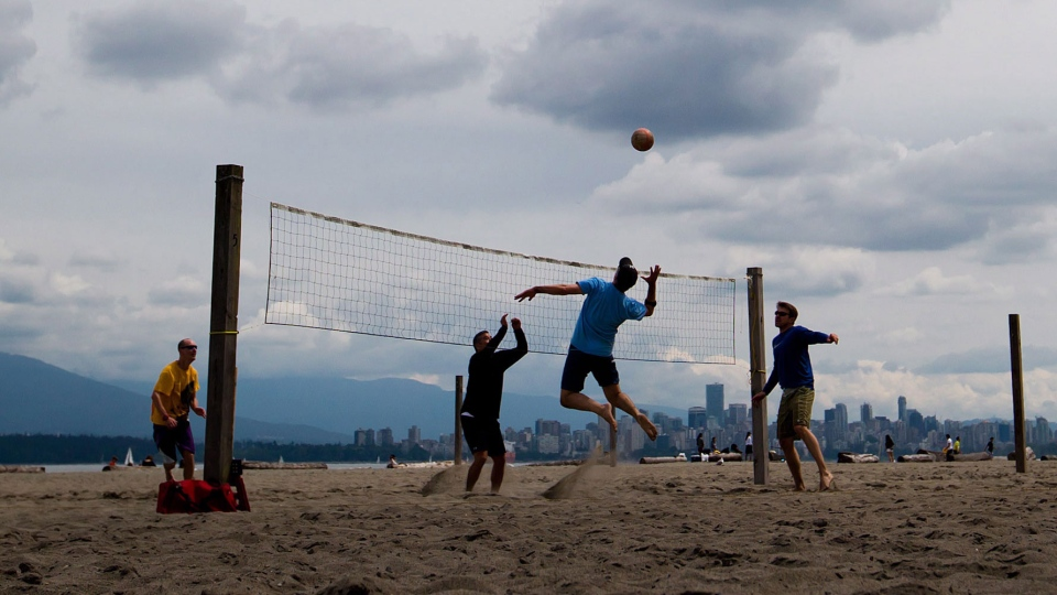 A group of men play volleyball at Spanish Banks Beach in Vancouver B.C., on Monday, May 20, 2013. (Darryl Dyck / THE CANADIAN PRESS)