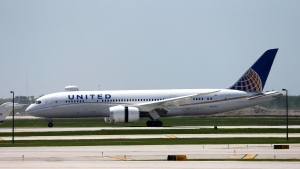 United Airlines Flight # 1 a Boeing 787 Dreamliner aircraft lands at Chicago's O'Hare International Airport Monday, May 20, 2013. (AP / Charles Rex Arbogast)