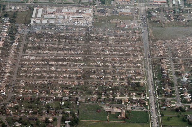 This aerial photo shows the remains of homes hit by a massive tornado in Moore, Okla., Monday, May 20, 2013. (AP / Steve Gooch)