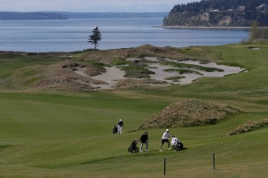 Golfers walk up the hill to the seventh hole at Chambers Bay in University Place, Wash., in this April 2013 file photo. (AP Photo/Ted S. Warren)