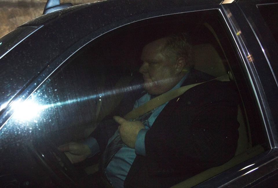 Toronto Mayor Rob Ford leaves the parking garage in his SUV avoiding the media after a city council meeting at Toronto City Hall on Tuesday, May 21, 2013. (Nathan Denette / THE CANADIAN PRESS)