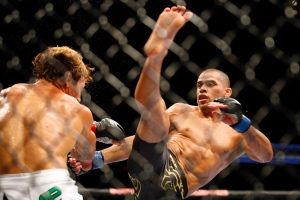 Ultimate Fighting Championship fighters Urijah Faber, left, from Calif., and Renan Barao, from Brazil, do battle during UFC 149 in Calgary, Alta., Sat., July 21, 2012. THE CANADIAN PRESS/Jeff McIntosh