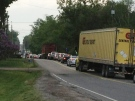 Traffic is diverted off Highway 6 onto Safari Road near Freelton, Ont., following a fatal crash on Tuesday, May 21, 2013. (Nadia Matos / CTV Kitchener)