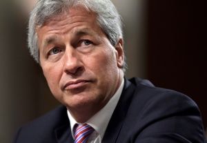 FILE - In this Wednesday, June 13, 2012, file photo, JPMorgan Chase CEO Jamie Dimon, head of the largest bank in the United States, testifies before the Senate Banking Committee on Capitol Hill in Washington. (AP Photo/J. Scott Applewhite, File)