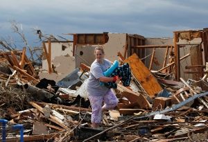 <b>75 Photos: Devastating Damage After Tornado Strikes</b>After a monstrous storm ripped through Oklahoma and Kansas, the search for survivors continues and residents begin to sift through the devastation. <br><br> Kandi Scott salvages items from the rubble of her home, which she shared with her mother, until it was destroyed Monday when a tornado moved through Moore, Okla., Tuesday, May 21, 2013. (AP / Brennan Linsley)