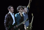 The Jonas Brothers, from left to right Nick, Joe and Kevin, perform at the Vina del Mar International Song Festival in Vina del Mar, Chile, Tuesday, Feb. 26, 2013. (AP Photo/Luis Hidalgo)